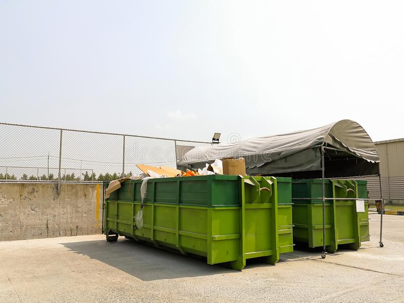Big Recycle bins to separate of waste like glass, paper, plastics, metals and other garbage form product plant to waste sorting. Plant dirty street container stock photo