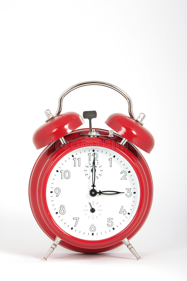 Big red alarm clock. With time at three o'clock. White background royalty free stock photo