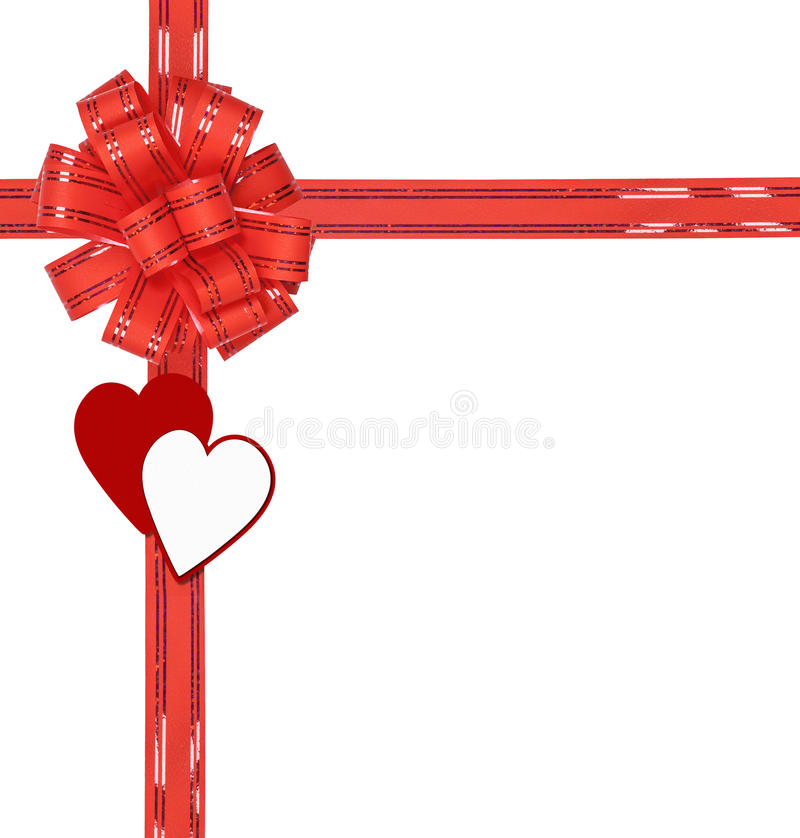 Big red bow with hearts isolated. On white background stock photos