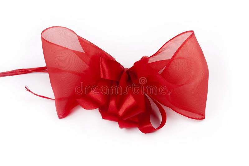 A big red bow / ribbon isolated on white background. Present packing, gifting, valentine`s day decoration or xmas gift concept stock images