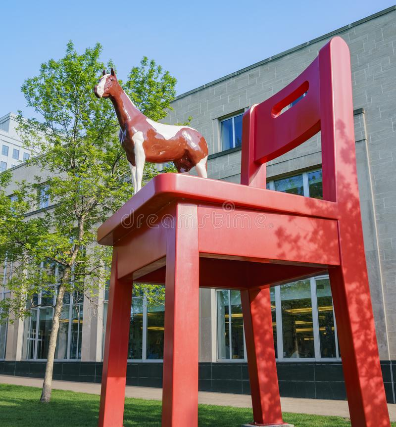 Big red chair and horse statue of the Denver Central Library. In the Civic center royalty free stock images