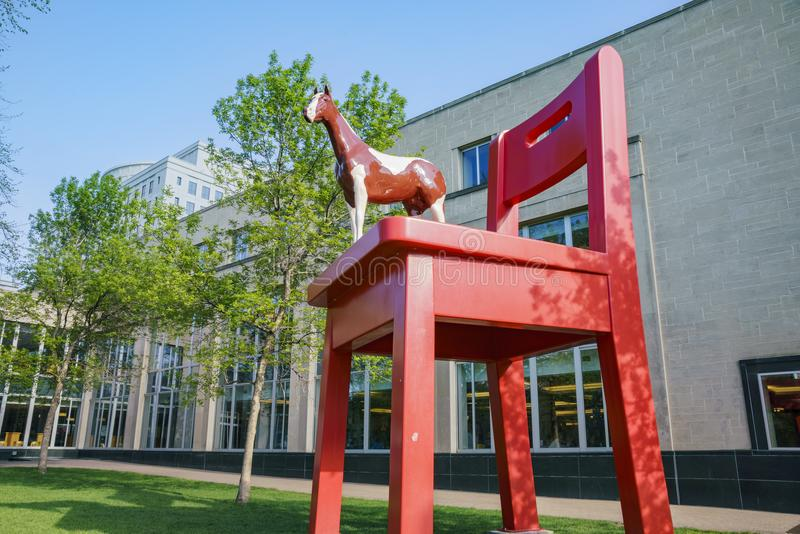 Big red chair and horse statue of the Denver Central Library. In the Civic center stock photos