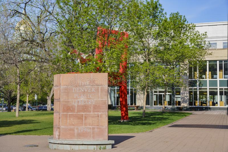 Big red chair and horse statue of the Denver Central Library. In the Civic center royalty free stock image