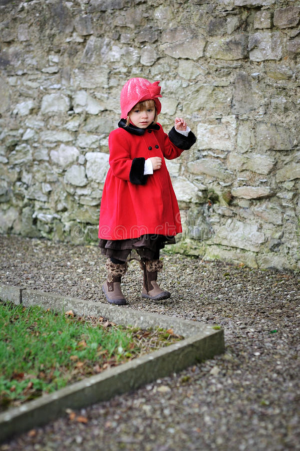 Big Red Coat. A little girl in a red coat royalty free stock photo