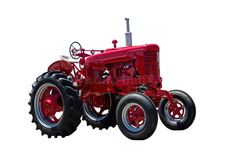 Big Red Farm Tractor Isolated On White. Horizontal shot of a big red farm tractor isolated on a white background royalty free stock images
