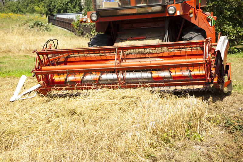 Big red harvester. Cuts the mature seeds of grain royalty free stock photos