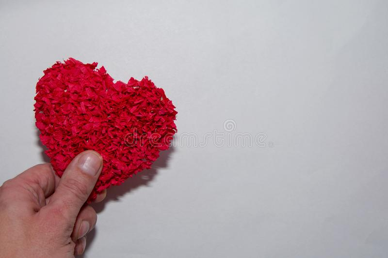Big red heart in hand on white background with copyspace. Valentines day card, hand holding heart, love, health. Concept royalty free stock image