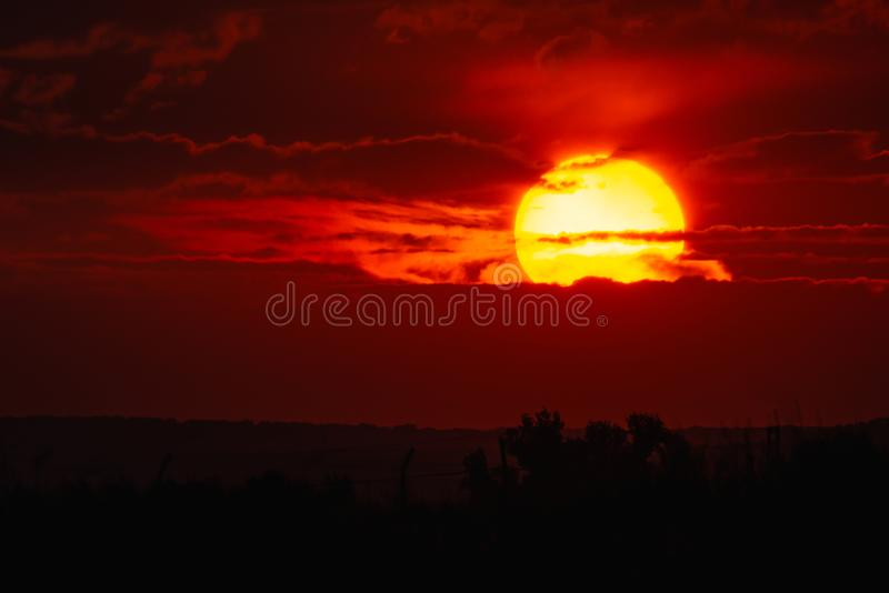 Big red sun and clouds in the sunset.  royalty free stock photos