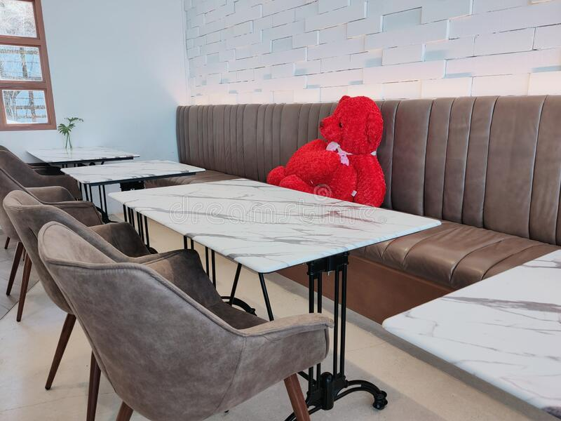 The big red teddy bear in the restaurant. stock image