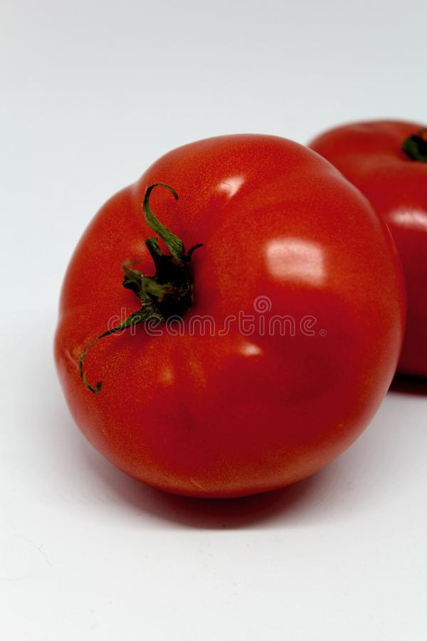 Big red tomatoes stock photo