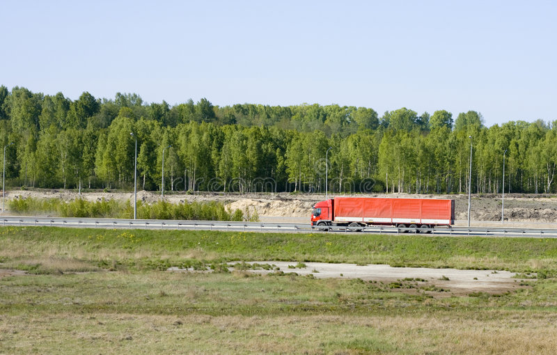Big red truck shot from far away