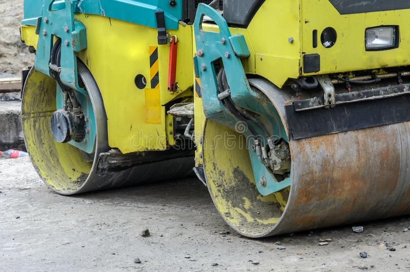 Big road roller on the construction site stock photography