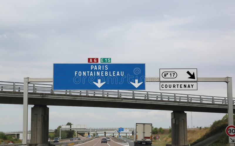 Big road signs on the busy French highway to go to Paris and Fon. Tainebleau or Courtenay city stock photos