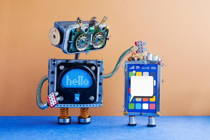 Big robot and mobile smartphone gadget. Funny robotic toy characters, creative design touch screen phone device, light. Bulb capacitors sim card. Blank sms royalty free stock image
