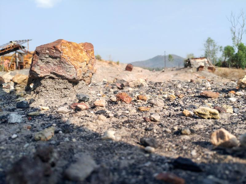 The big rock is above the ground caused by weathering at abandoned area stock image