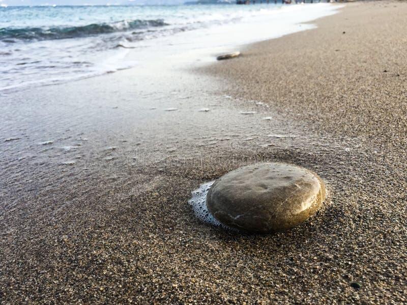 Big rock on Beach. Close up background royalty free stock photos