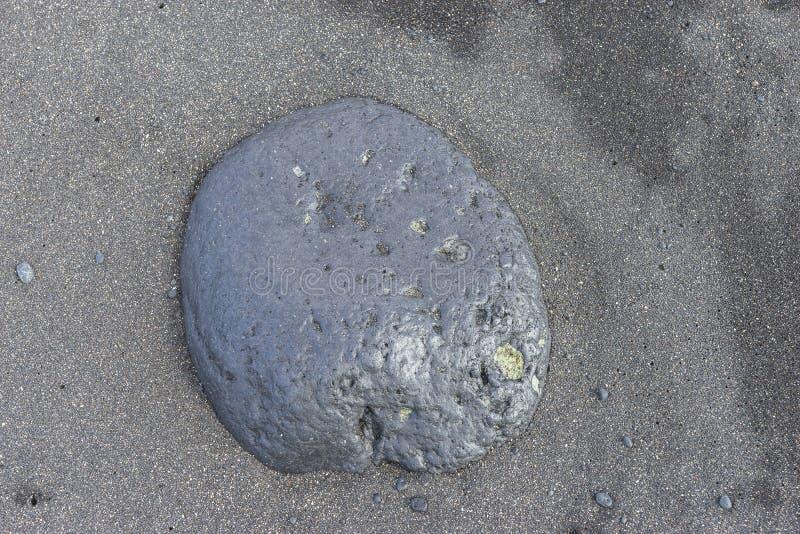 Big rock on the beach. Big rock on the coast line . Lanzarote  island , Spain , el Golfo Lagoon  . As a background stock photo