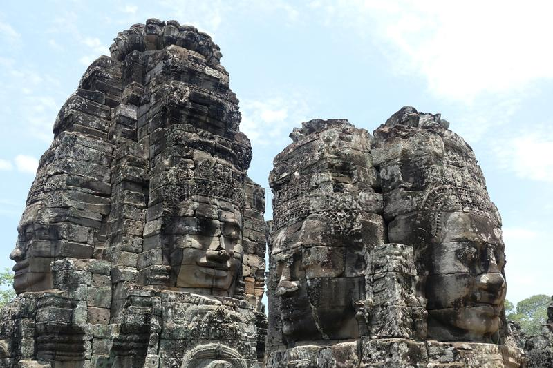 Rock faces in the temple of Bayon, Angkor, Cambodia. Big rock faces in Bayon temple, so beauiful and huge !!! 4 heads for one big statue royalty free stock image