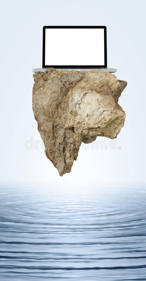 Download Big Rock Floating With Laptop Stock Photo - Image: 34572410