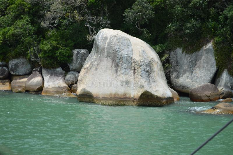 Big rock at island in Goat`s Island. This big rock is in Goat`s Island shore. This small island is in front of the bay in Camburiú - SC, Brazil royalty free stock photo