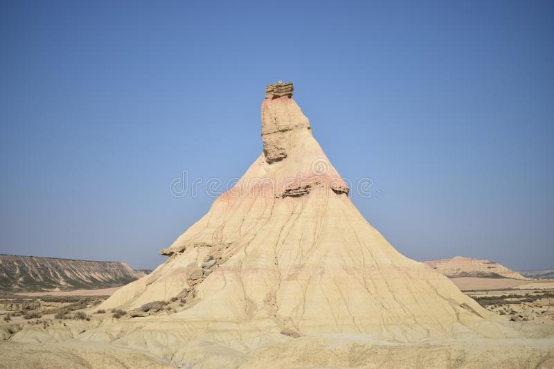 Big rock in the middle of the desert. Big rock monument in the middle of the desert. Blue sky without clouds stock images