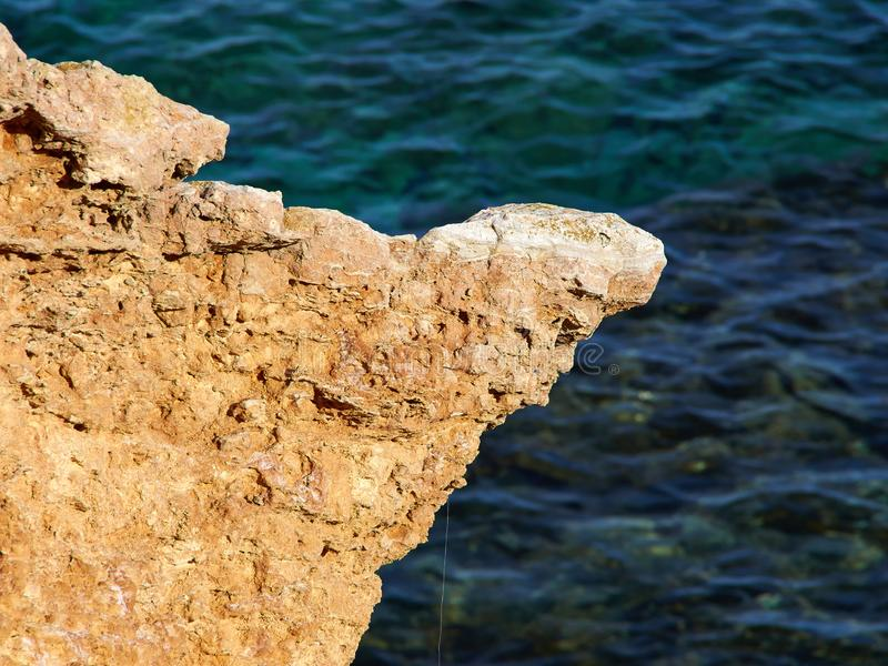 Big rocks by clear deep blue sea ocean Costa Blanca Spain. Summer vacation nature background image stock photos