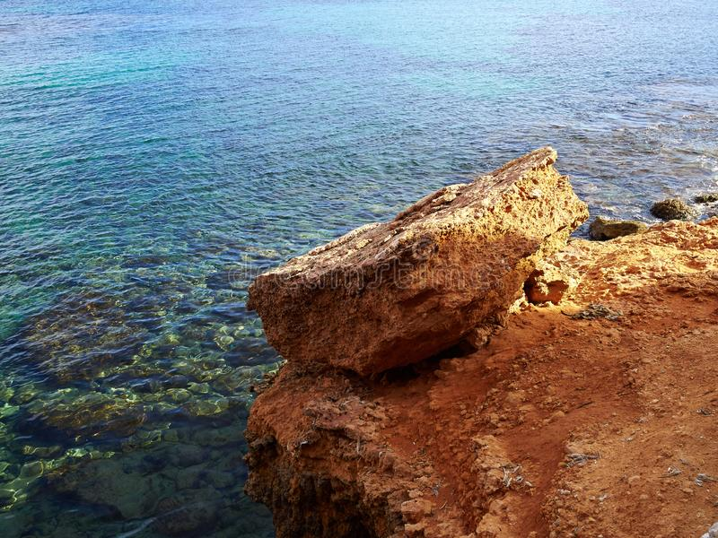 Big rocks by clear deep blue sea ocean Costa Blanca Spain. Summer vacation nature background image royalty free stock photography