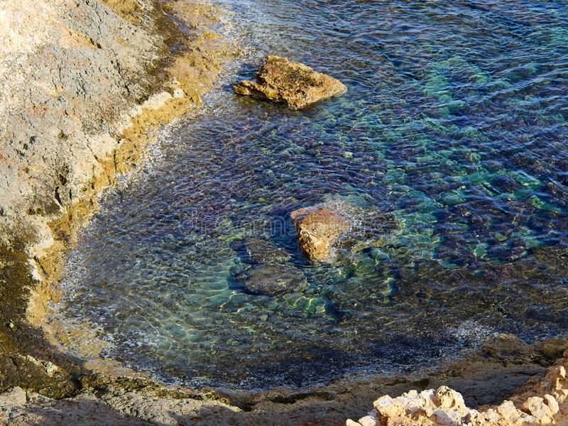 Big rocks by clear deep blue sea ocean Costa Blanca Spain. Summer vacation nature background image stock images
