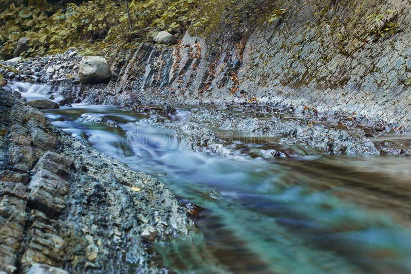 Big rocks in waterfalls of mountains river mountains. Water mountains landscape. Idea for outdoor activities, travel. royalty free stock images