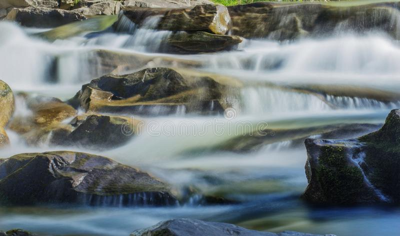Big rocks in waterfalls of mountains river mountains. Water mountains landscape. Idea for outdoor activities, travel. stock photo