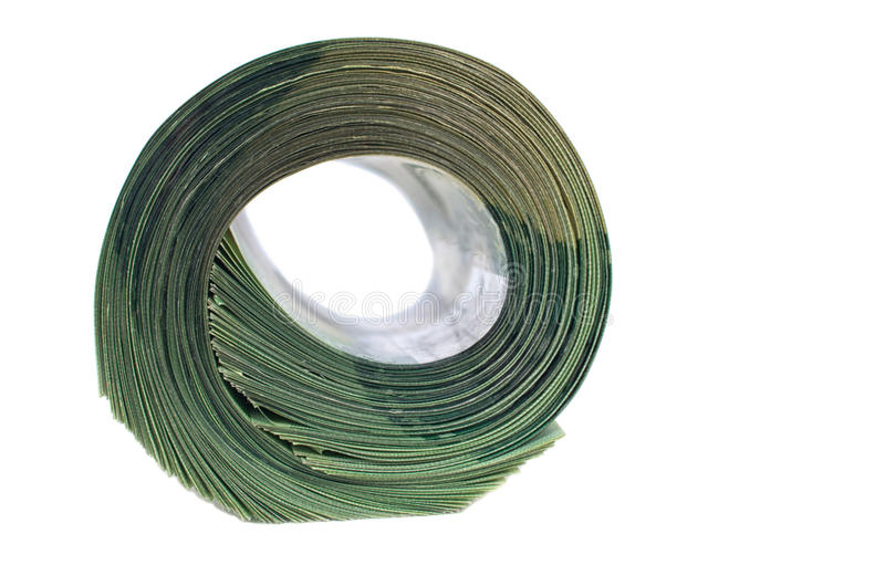Big roll of green banknotes. Isolated on wooden background royalty free stock photos