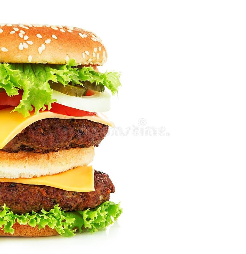 Big royal appetizing burger, hamburger, cheeseburger close-up isolated on a white background royalty free stock photography