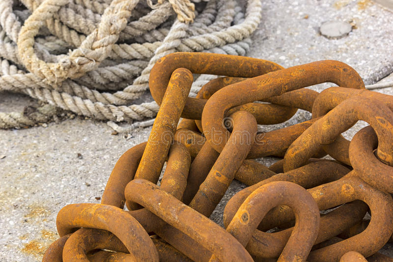 Big rusty chain and a sailing rope royalty free stock images