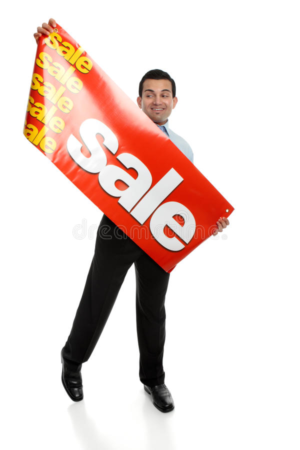Big Sale. A man about to hang up a large Sale banner sign. Suitable for many uses, retail, Christmas,clearance, etc. Focus to the sign royalty free stock images