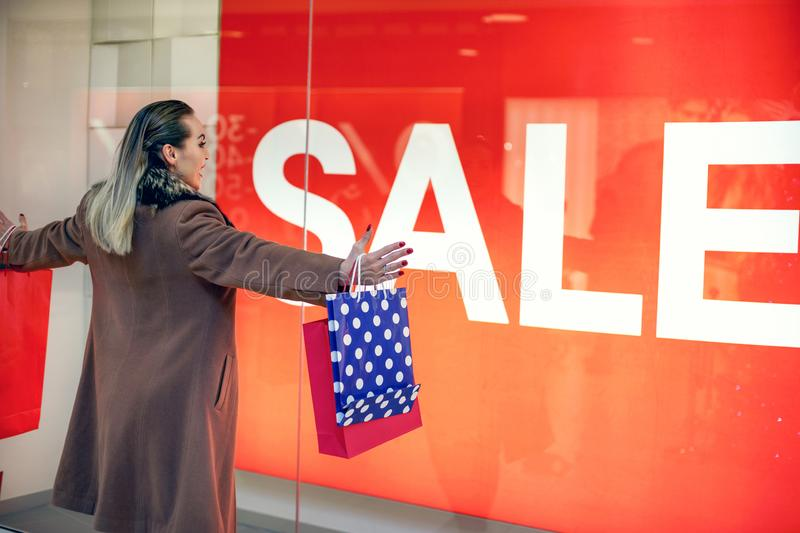 Big Sale- Consumerism, shopping, lifestyle concept Woman in shop stock photo