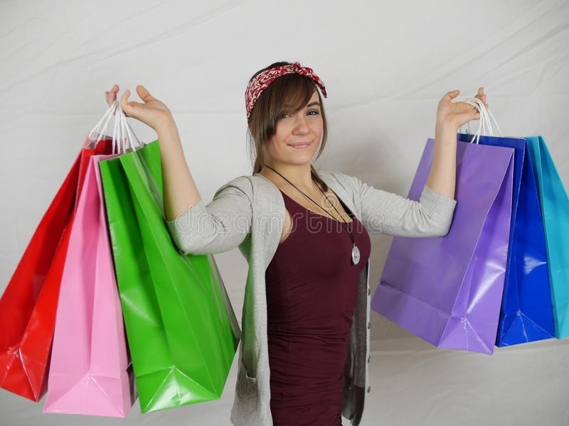 The Big Sale - discount special bargain thrifty shopper. This college student shopper proudly shows of the great deals she found at the big sale. She found stock photos