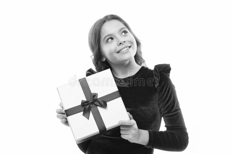 Big sale in shopping mall. small girl after shopping. Boxing day. Little girl with present box. Happy birthday gift. Own. Business. cute daydreamer. Nice royalty free stock image