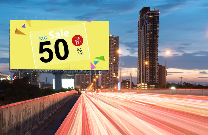 Big sale special offer. Billboard and banner. Outdoor advertising poster at night time with street light line for advertisement street city night royalty free stock photography