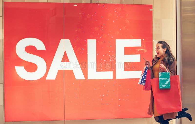 Big Sale- Woman in shopping. woman with shopping bags enjoying i stock photography