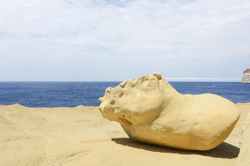 Big sand stone on the background of the sea stock image