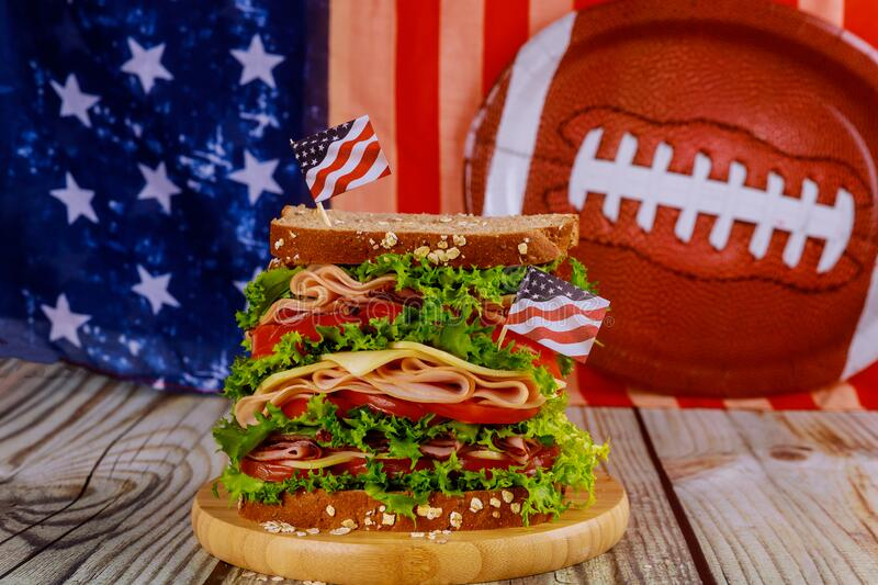 Big sandwich for american football game party stock photography