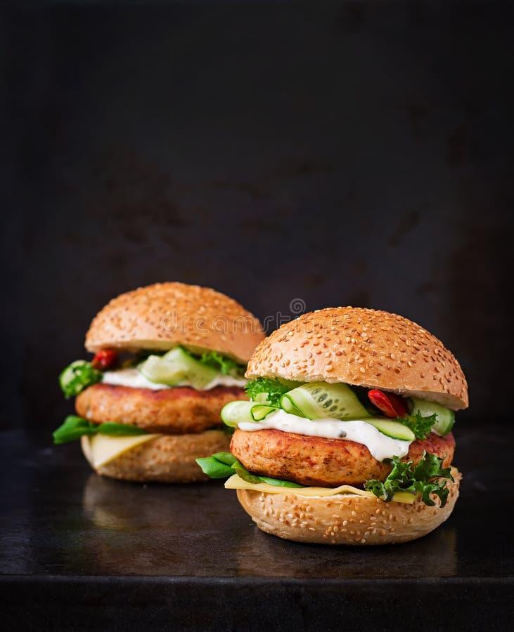Big sandwich - hamburger with juicy chicken burger stock image