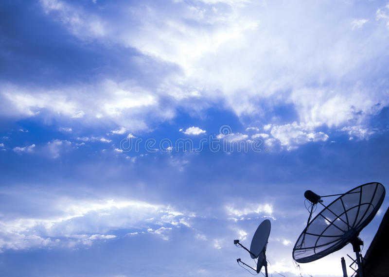 Big Satellite Dish on blue sky. Big Black Satellite Dish on blue sky royalty free stock image
