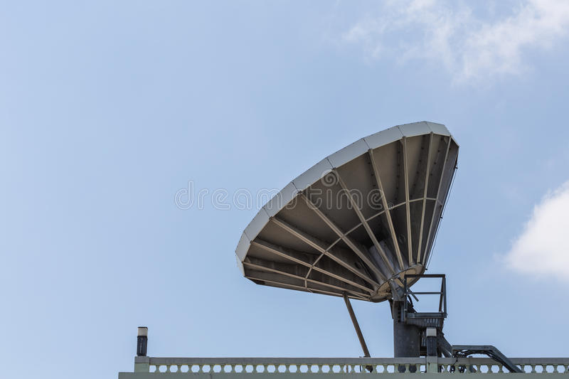 Big satellite dish on the roof royalty free stock photography