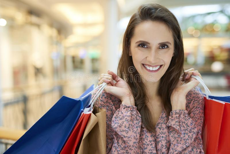 Big satisfaction after big shopping in shopping mall stock photography