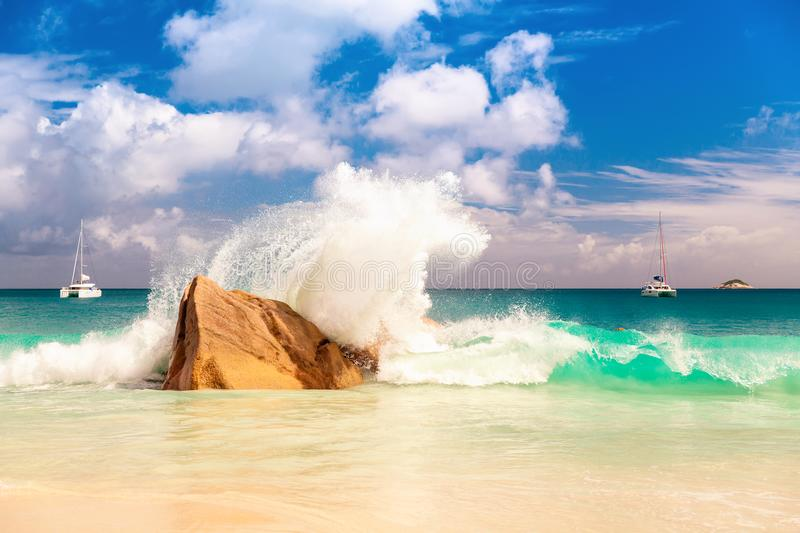Big sea wave breaking on the shore rock with stunning blue ocean royalty free stock photography