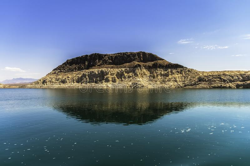 Sedimentary rock formation alongside the Lake Mead royalty free stock photography