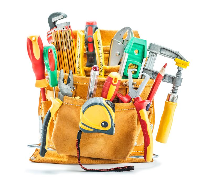 Big set of construction tools in yellow tool belt isolated on white stock photography