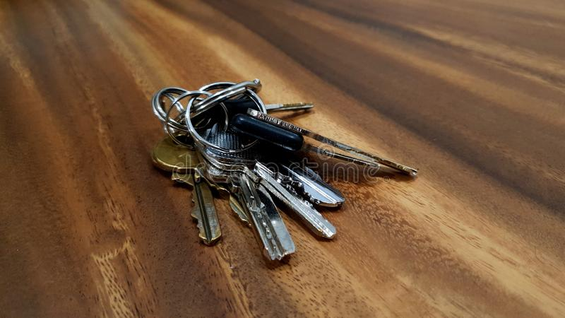 Bunch of keys. A big set of house and business keys. Metaphors of success, new homes, puzzle to solve, mystery, business stock image