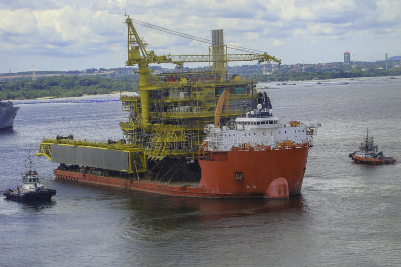 Big ship carrying oil & gas offshore platform structure royalty free stock images
